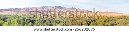 Panorama from a village in  the Moroccan mountains in Morocco on the thousand Kasbah road. Oasis in Sahara desert area - stock photo