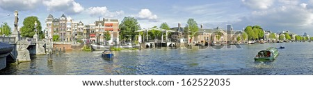Panorama from Amsterdam innercity with the Amstel in the Netherlands - stock photo
