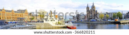 Panorama from Amsterdam with the Central Station in the Netherlands - stock photo
