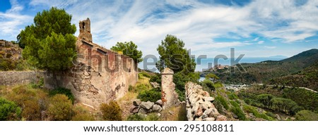 Panorama from old church on beautiful Capraia island with town and harbour and Elba in background, Tuscany, Italy, Europe - stock photo