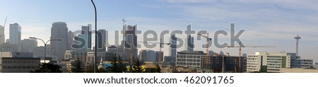 Panorama,  high rise construction cranes  across downtown  Seattle, Washington