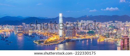Panorama Hong Kong Skyline from Victoria Peak at dusk - stock photo