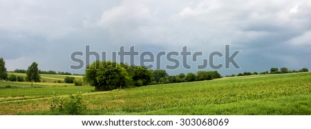 Panorama Hungarian landscape with hills and clouds