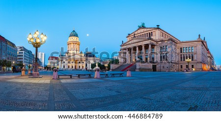 Panorama image of Gendarmenmarkt square in Berlin with German church and Concert Hall at dawn - stock photo