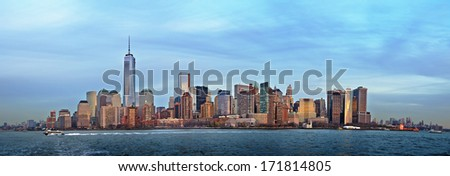 Panorama image of the financial district in Lower Manhattan, New York City in soft evening light. The new One World Trade Center can be seen as the highest building.