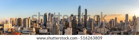 Panorama in center of Bangkok city, where is the business area in Thailand. There are a lot of modern building, condominium and office in downtown with sunset time.