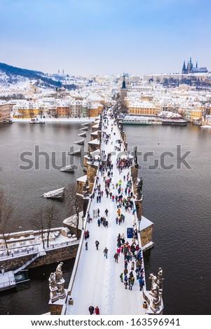 Panorama. Karlov or Charles bridge in Prague in winter - stock photo