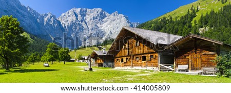 panorama landscape in alps mountains and farm house - stock photo