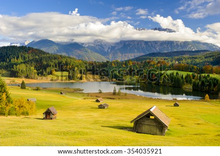 panorama landscape in Bavaria, Germany, with alps mountains and lake at autumn - stock photo