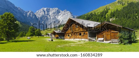 panorama landscape in Bavaria with alps mountains and wooden hut - stock photo