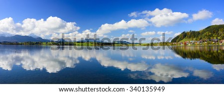 panorama landscape in Bavaria with mountains mirroring in water - stock photo