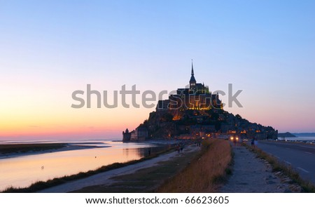 Panorama Le Mont-Saint-Michel in the twilight - stock photo