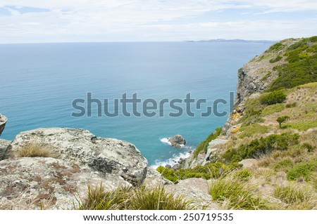 Panorama lookout from plateau over ocean at Bass Strait, Tasmania, Australia, view to horizon with mountains and copy space. - stock photo