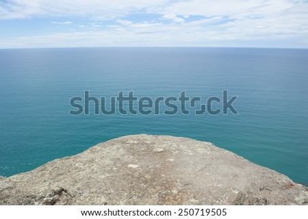 Panorama lookout over ocean at Bass Strait, Tasmania, Australia, at edge of rocky platform, view to horizon and copy space. - stock photo
