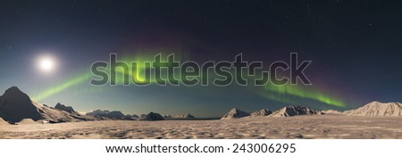 PANORAMA - Northern Lights above the Arctic glacier and mountains - stock photo