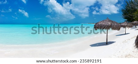 Panorama of a beautiful tropical beach and Caribbean sea - stock photo