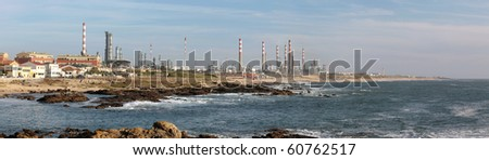 Panorama of a big oil refinery by the sea - stock photo