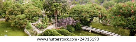 panorama of a botanical garden in bloom - stock photo