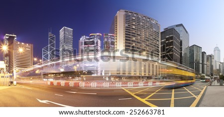 Panorama of a busy road in Hong Kong from day to night, produced by stitching multiple images together - stock photo