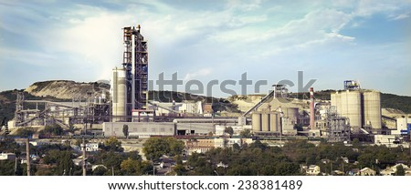 panorama of a cement plant in a sunny summer afternoon - stock photo