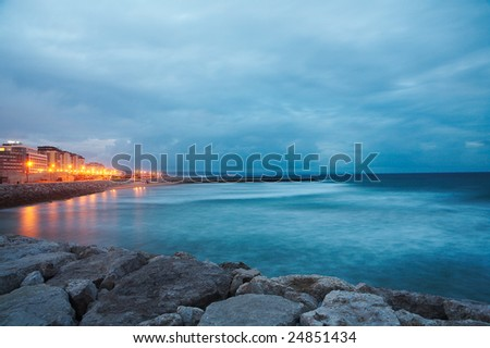 Panorama of a coastline and Atlantic ocean after sunset, Lisbon, Portugal - stock photo