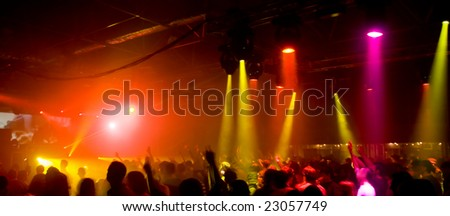Panorama of a concert with laser show - stock photo