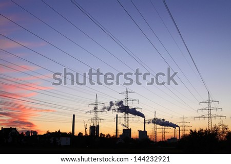 Panorama of a industry landscape with power plant and utility towers - stock photo