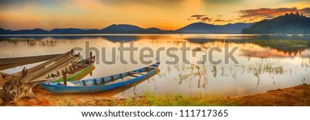 Panorama of a Lak lake at sunrise - stock photo