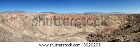 panorama of a Mojave Desert canyon in Southern California with the Salton Sea in the distance