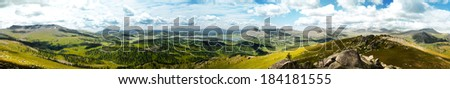 Panorama of a mountain valley - stock photo