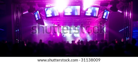 Panorama of a music festival with laser show - stock photo