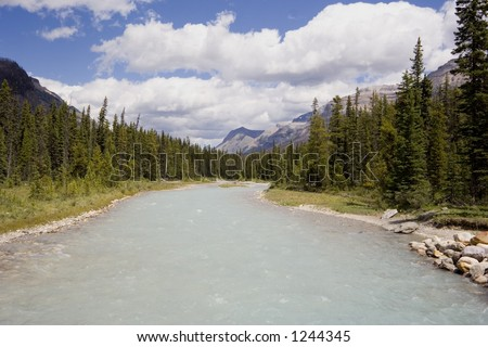 panorama of a river with glacial water - kootenay national park, BC, canada - stock photo