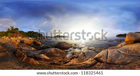 Panorama of a rocky coast of Andaman sea near Laem Sing beach at sunset. Phuket, Thailand - stock photo