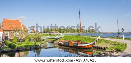 Panorama of a sailing ship at a dike in Enkhuizen, Netherlands - stock photo