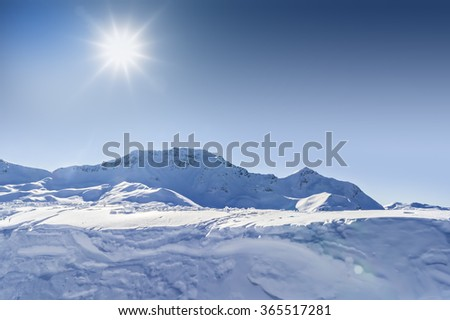 Panorama of a snow-covered slope of the Alps. Beautiful winter landscape