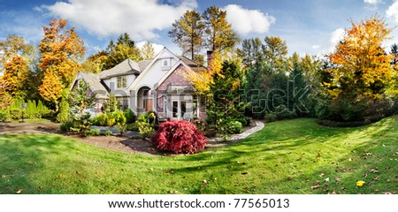 Panorama of a suburban house on a sunny fall afternoon - stock photo