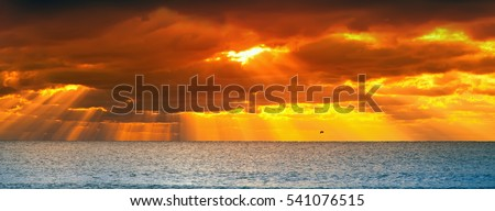 panorama of a sunset over the ocean