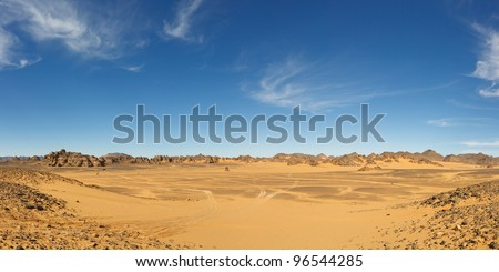 Panorama of a vast valley in the Akakus Mountains, Sahara Desert, Libya - stock photo