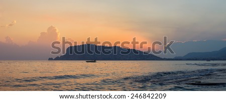 Panorama of Alanya peninsula at dusk - stock photo