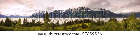 Panorama of Alaska, with the turn around arm and snow on the mountains - stock photo