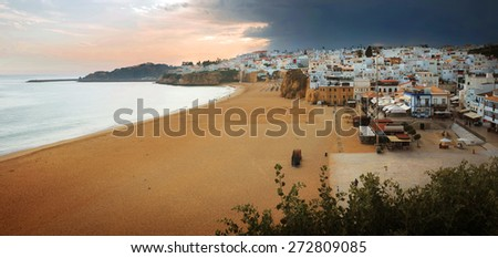 Panorama of Albufeira town and empty beach in Portugal in the evening - stock photo