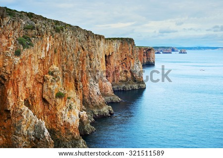 Panorama of Algarve sea shore with moody sky. Portugal - stock photo