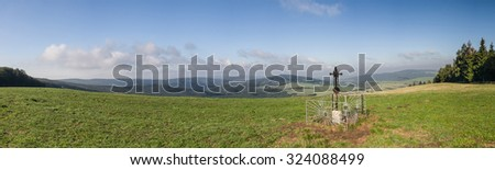 Panorama of amazing summer countryside with metal Christian cross under blue sky - White Carpathian Mountains, Czech Republic, Europe - stock photo