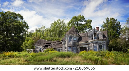Panorama of an abandoned, falling down house - stock photo