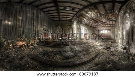 panorama of an abandoned theater with a destroyed ceiling, hdr processing - stock photo