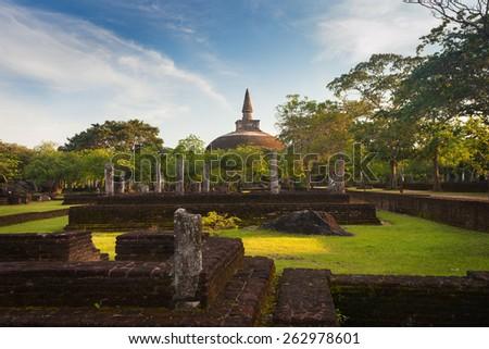 Panorama of ancient ruins in Polonnaruwa with Rankoth Vihara golden Pinnacle dagoba, Unesco, Sri Lanka, Asia - stock photo