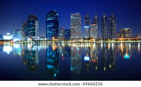 Panorama of Bangkok city downtown at night with reflection of skyline, Bangkok,Thailand