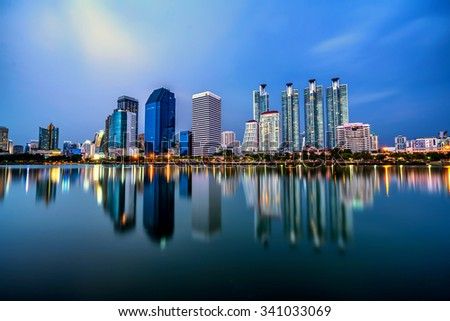 Panorama of Bangkok city downtown at twilight with reflection of skyline, Thailand. - stock photo