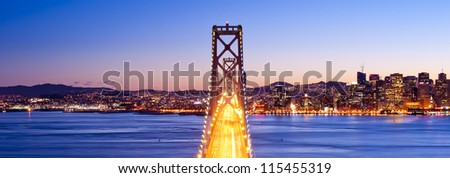 Panorama of Bay Bridge at sunset. San Francisco, USA. - stock photo