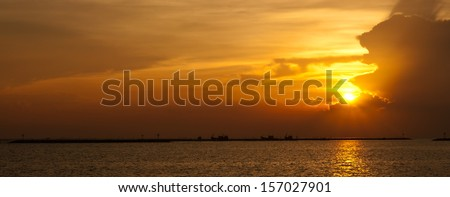 panorama of beautiful and romantic sunset over coastline